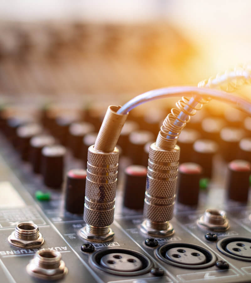 Cables Plugged Into a Mixing Board